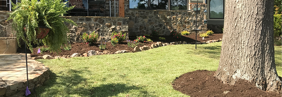 Three Shovels quality lawncare, retaining wall